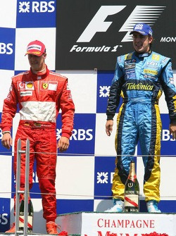 Podium: race winner Fernando Alonso with Michael Schumacher