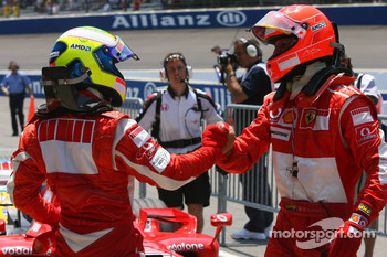 Pole winner Michael Schumacher celebrates with Felipe Massa