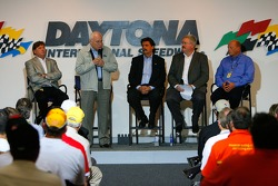 U.S. Vice President Dick Cheney speaks on stage with VP of Competitions Robin Pemberton, NASCAR President Mike Helton, Managing Event Director David Hoots, and NASCAR Nextel Cup Series Director John Darby