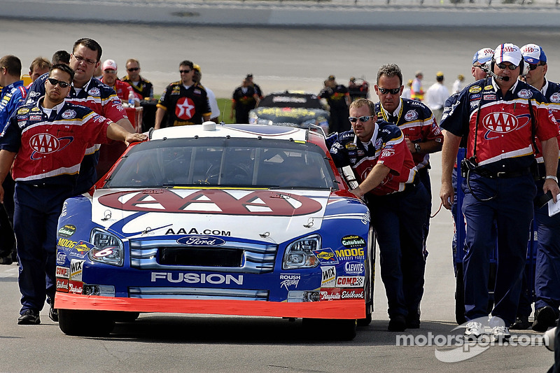 Mark Martin's car is pushed to qualifying line