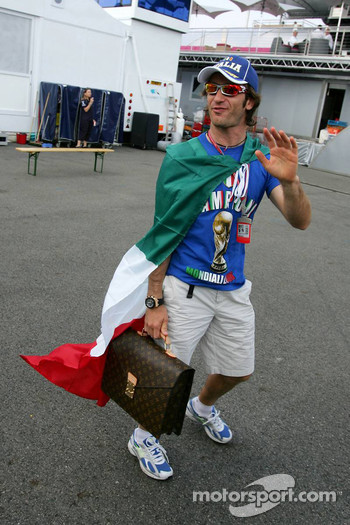 Jarno Trulli celebrates Italy's win at the World Cup