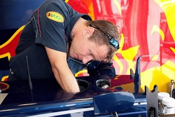 Red Bull Racing mechanics prepare their cars for the weekend