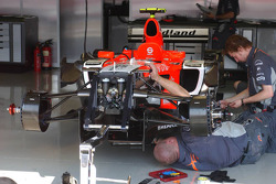 Midland mechanics work on the car of Tiago Monteiro