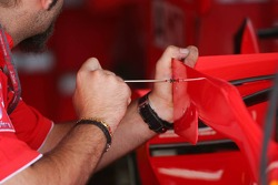 Ferrari mechanic changes the small adjustable wings