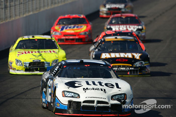 Ryan Newman leads a pack of cars