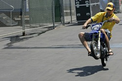 Colin Edwards shows-off on his pit bike