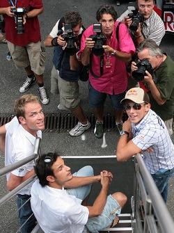 Robert Doornbos, Vitantonio Liuzzi and Christian Klien with photographers
