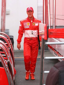 Michael Schumacher leaves the garage after failing to qualify for Q3
