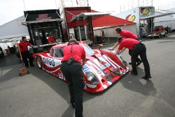 CITGO Racing crew members push the car to pitlane