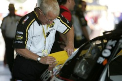 A NASCAR official at tech inspection