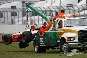 Champ Car safety crew takes the car of Oriol Servia back to the paddock area