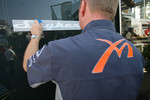 Spyker stickers are applied to the Spyker MF1 Racing trucks