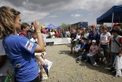 Sébastien Loeb poses with fans