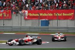 Jarno Trulli leads Ralf Schumacher