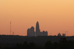 A view of the Charlotte skyline as the sun sets minutes before the race