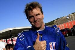 Pole winner Stefan Johansson celebrates