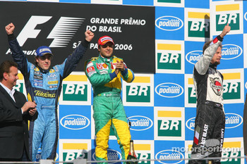 Podium: race winner Felipe Massa with 2006 World Champion Fernando Alonso and Jenson Button