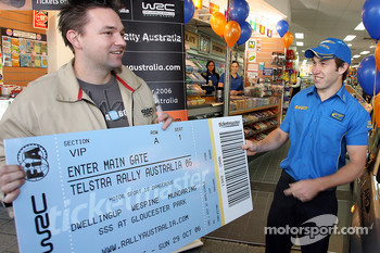 Chris Atkinson hands over the first ticket for the 2006 Rally Australia
