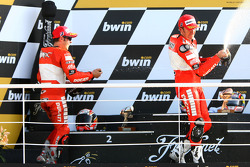 Podium: champagne for Loris Capirossi and Troy Bayliss