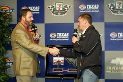 Texas Motor Speedway President Eddie Gossage presents Jeff Burton with a momento from the Texas Motor Speedway
