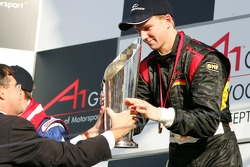 Jan-Peter Balkenende, Dutch Prime-Minister, hands Nico Hulkenberg the winners trophy