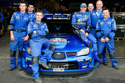 Petter Solberg poses with SWRT technicians