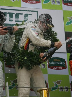 Podium: champagne for Jorg Muller