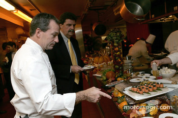Executive Chef John Doherty, shows NASCAR President Mike Helton the layout of all the food at the champion's welcome dinner in the Excutive Kitchen at the Waldorf-Astoria Hotel