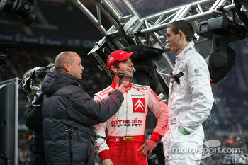 Sébastien Loeb with the winner of the Playstation game