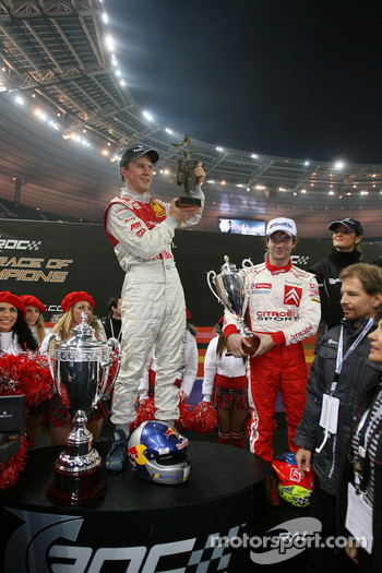 Race of Champions winner Mattias Ekström celebrates with Sébastien Loeb