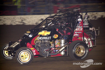 Past O'Reilly Chili Bowl Nationals champions Tracy Hines (21) and Jason Leffler (71J) engaged in a spirited duel for the fourth and final Oklahoma Dodge Dealers Championship Feature event