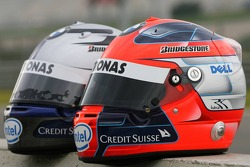 Helmets of Robert Kubica and Sebastian Vettel
