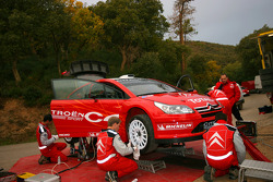 Citroën team members work on the C4 WRC