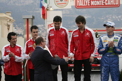 Podium: Prince Albert II of Monaco congratulates winners Sébastien Loeb and Daniel Elena