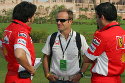 Rubens Barrichello talks with Ferrari team members