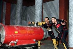 Vitantonio Liuzzi and Scott Speed behind a wind machine