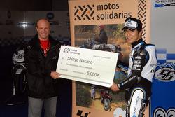 Shinya Nakano gives a check