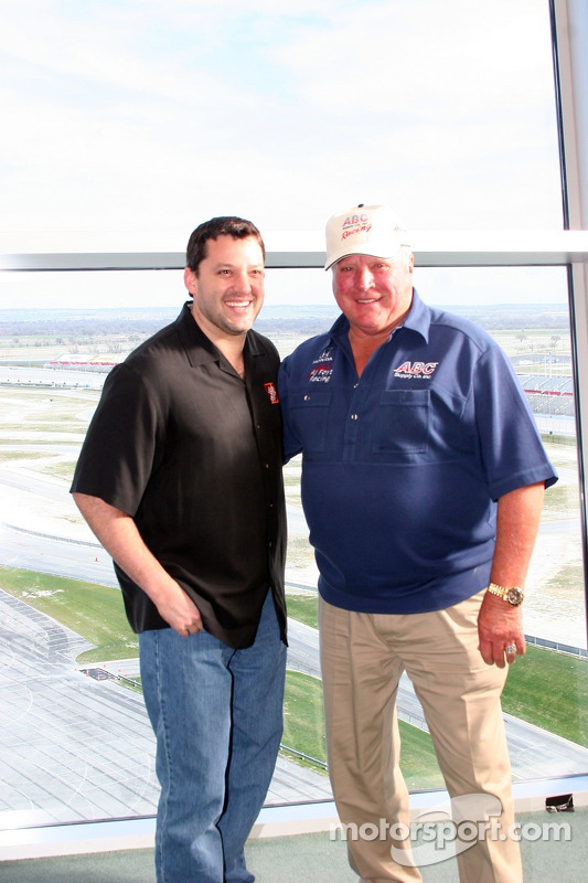 Tony Stewart and A.J. Foyt Jr. share a laugh at the Texas Motor Speedway