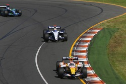 Heikki Kovalainen, Renault F1 Team, R27 and Nico Rosberg, WilliamsF1 Team, FW29