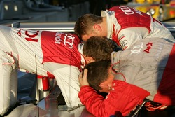 Tom Kristensen, Allan McNish and an Audi Sport North America team member