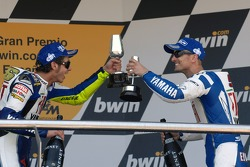 Podium: race winner Valentino Rossi celebrates with Colin Edwards