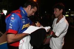 Jason Bright signing for a fan