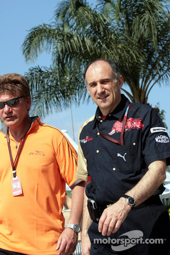 Team principal Franz Tost with a journalist walk through the paddock