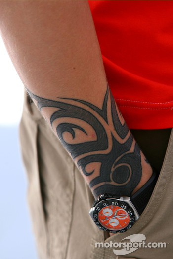 Kimi Raikkonen, Scuderia Ferrari, has a tattoo on his arm