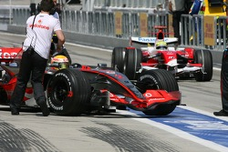 Lewis Hamilton, McLaren Mercedes, MP4-22 and Ralf Schumacher, Toyota Racing, TF107