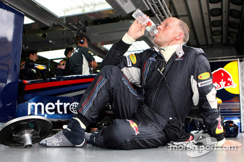 A Red Bull Racing, team member takes a break
