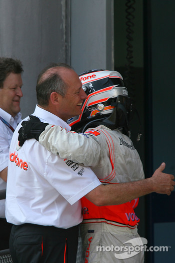 Race winner Fernando Alonso celebrates with Ron Dennis