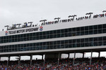 Spotters high on the roof on a very windy and cold day at Texas Motor Speedway