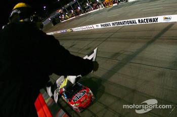 Race winner Jeff Gordon takes the chequered flag