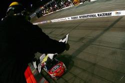 Race winner Jeff Gordon takes the chequered flag